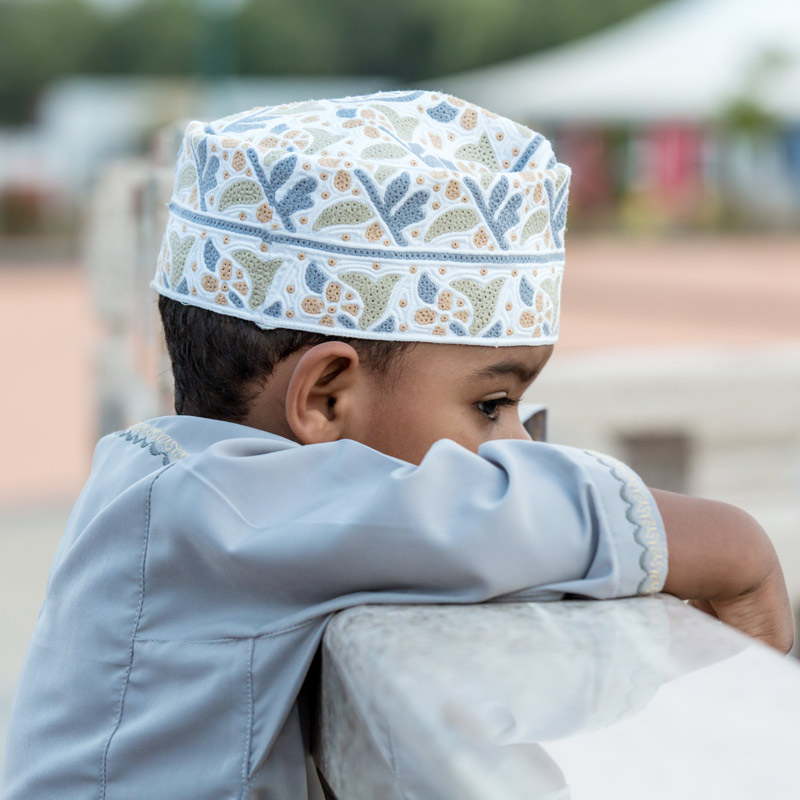 Child in Taqiyah Standing on Roof Waiting for Someone
